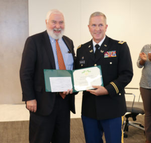 Lieutenant Colonel Edward O'Sheehan (right) presents the Governor's Florida Commendation Medal to Miami partner Steve Maher.