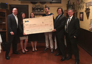 Shutts attorneys present Kids in Distress with $5,000.00 donation.