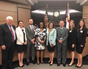 Pictured from left to right are John Romano, Jen Lipinski, Sean Smith (moderator), Judge Cymonie Rowe, Traci Rollins, Judge Joseph Curley, Jen Lettman, and Megan McNamara.